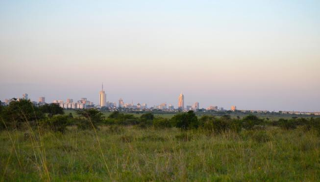 Nairobi, Kenya skyline view from Nairobi National Park with African Savannah grassland in foreground