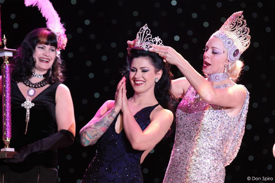 LouLou D'vil is crowned by Miss Exotic World 2012, the previous Reigning Queen of Burlesque, Imogen Kelly. ©Don Spiro