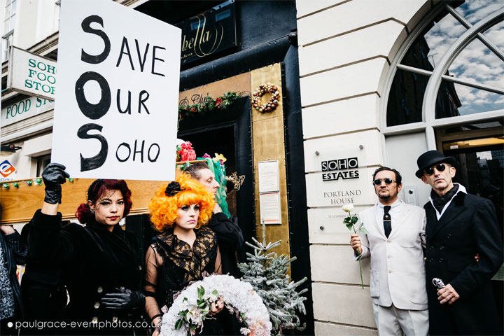 The procession stopped outside the Soho Estates offices on the way to Madame Jojo's.  ©Paul Grace (www.paulgrace-eventphotos.co.uk)