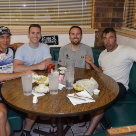 Nestled in the corner booth at Mitchell's. L to r: with young Dave, Chris Miller (veteran rider and now crew member) and Lincoln.