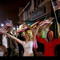 Why does Boston celebrate Martial Law with chants of 'USA, USA'?
