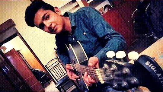 Mohammad Samad playing the guitar