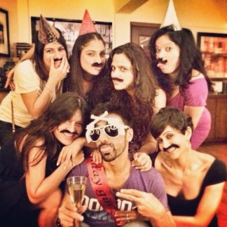 Ashish Chowdhry with a glass of wine