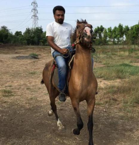 Hemant Kher riding a horse