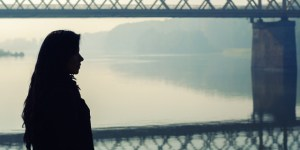 web3-depressed-woman-bridge-silhouette-shutterstock_355955540-shutterstock