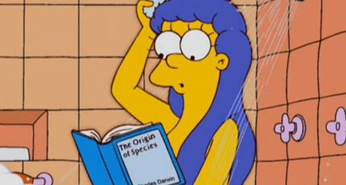 Marge reads. In the shower.