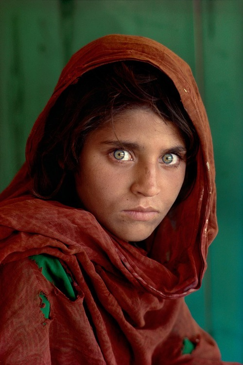 Afghan Girl by Steve McCurry Sharbat Gula (born ca. 1972) is an Afghan woman who was the subject of a famous photograph by journalist Steve McCurry. Gula was living as a refugee in Pakistan during the time of the Soviet occupation of Afghanistan when she was photographed. The image brought her recognition when it was featured on the cover of the June 1985 issue of National Geographic Magazine at a time when she was approximately 12 years old.
