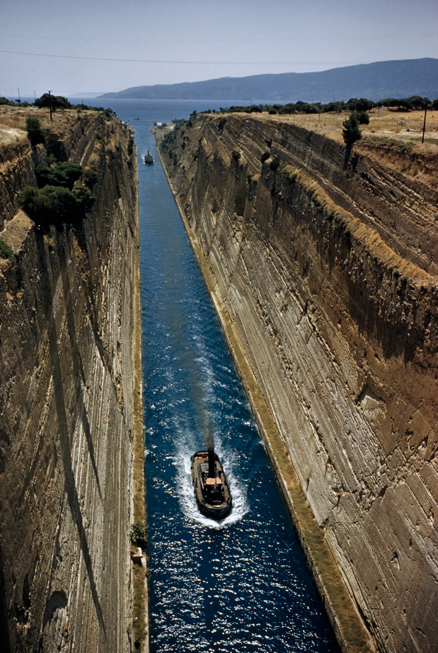 Boats ferry through a canal to bypass the Peloponnesus in Corinth, Greece, December 1956.Photograph by David Boyer, National Geographic