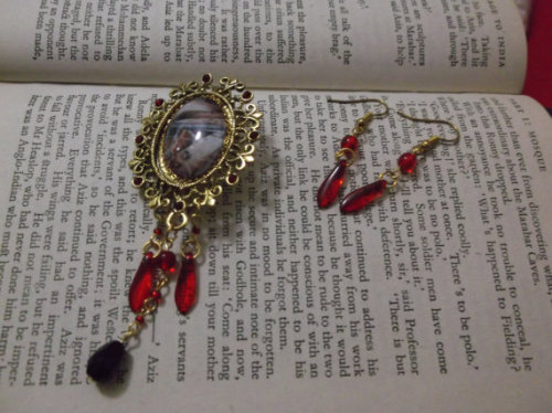 "Large brass gold-tone setting with red seed-bead ""jewels"", glass cabochon with anatomical illustration (as featured in ""Doctors & Dissection Men"") encircled with fine gold plated chain, gold plate pins and rings, glass beads, and a standard brooch back. Gold plate fish hook wire earrings with gold plate rings, and glass beads.The perfect present for fans of the macabre, the mystery of the human body, or just unusual and outstanding jewellery, this brooch will liven up any outfit, from an elegant dress to a lab coat, and with matching earrings to complete the bold and daring look there is sure to be no one as anatomically-dressed at any event you attend (unless Heidi Klum is there!).(listing is the click-through link)"