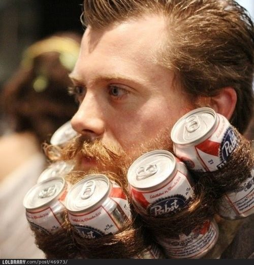Man with beer cans rolled into long hipster beard. Ugh.