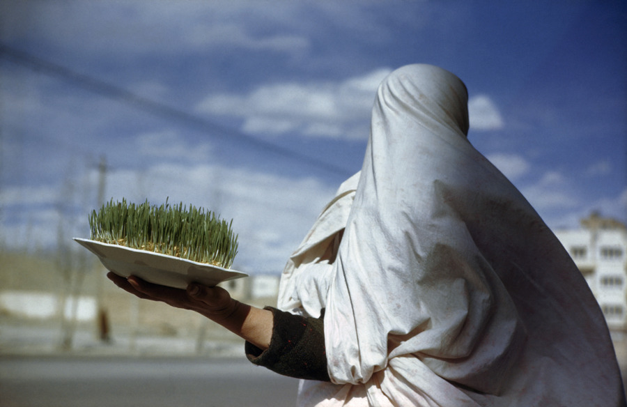 Woman holds plate containing new grain sprouts to celebrate the new year in Tehran, Iran, March 1947.Photograph by Maynard Owen Williams, National Geographic