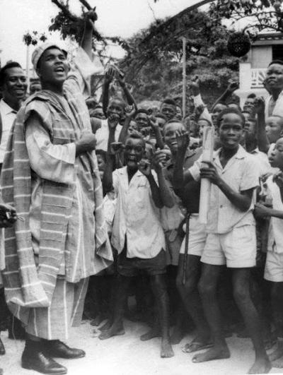 World heavyweight boxing champion Muhammad Ali, wearing the Nigerian  Agbada, shouts to the crowd of youngsters who met him on his arrival in Lagos, Nigeria. (June 1, 1964). Source: Sacbee<br /><br /><br /><br /><br /><br /><br /><br /><br /><br /><br /><br /><br /><br /><br /><br /><br /><br /> More Vintage Nigerian photos