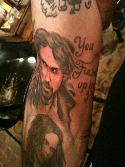 "Bam's Tattoo of Chad says. ""You fucked up in 93"" If you have watched it you"