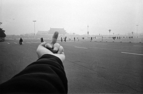 Ai Weiwei, Study of Perspective—Tiananmen Square, part of a series (1995–2003) where he gave the finger to landmarks all over the world.<br /> Chinese artist Ai Weiwei, whose installation of ceramic sunflower seeds at the Tate Modern in London a few weeks ago opened to widespread news coverage and glowing reviews, has just been placed under house arrest in Beijing (BBC story and video).<br /> Update: released.
