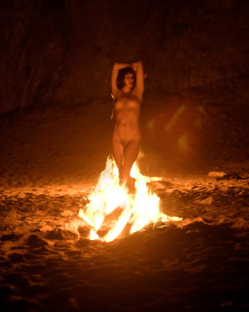 I would never stand in a fire in the nude let alone with clothes on. o.O I can literally say that, that looks hot though. ;]