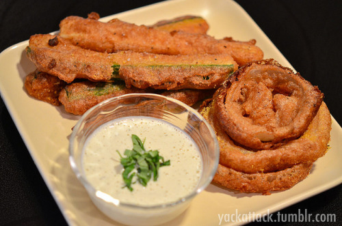 Beer Battered Zucchini & Onion Rings with Raw Vegan Ranch! Warning: this recipe is INDEED as good as it sounds, and is also probably one of the unhealthiest things on my blog. I haven't had fried zucchini or onion rings in ages and need to use the rest of the squash that I pulled from my garden, and also had a recipe sent to me that was Beer Battered Avocado fries; so I combined the two to create this magical meal.Ingredients: One 12 oz. Alaskan White (belgian) or any light beer 1 Cup Whole Wheat flour (may need to add a couple more tablespoons) 1 Tbsp. Nutritional Yeast 2 tsp. Paprika 1 1/2 tsp. Sea Salt 1 tsp. Garlic Powder 1 tsp. Onion Powder A pinch of Cayenne Pepper 3/4 lb. Zucchini/Summer Squash, cut into long sticks 1 Whole White Onion, Sliced into rings Vegetable Oil, as needed for fryingDirections: Mix all dry ingredients in a low, wide dish; then pour in beer and whisk together until there are no clumps. If the batter seems too runny, add a little more flour; you want it to be able to coat the zucchini without completely clumping on it. Set batter aside in the refrigerator for 1-2 hours.Fill pan or fryer with the oil and heat to roughly 375F, if you are using a pan (like I did) this is somewhere between medium and high heat. Dip each zucchini stick in the batter and make sure it is entirely coated, use a fork or two to lift it out of the batter and CAREFULLY place it into the hot oil. Fry until golden brown, 2-3 minutes; then take out of the oil, drain off as much oil as possible, place on a paper towel covered plate and sprinkle sea salt and nutritional yeast over them. The same instructions apply to the onion rings. For the Raw Vegan Ranch! I found this SUPER EASY ranch recipe on The Sunny Raw Kitchen, except that I made only a third of it (it's a huge recipe). It tastes amazing, no lie, and doesn't involve processed ingredients like store bought vegan mayo. This ended up being a perfect dipping sauce for my fried yummies!