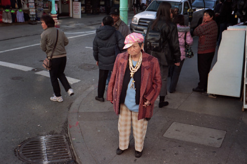 A helpful dressing-myself rule I usually follow is to take stock of my outfit and then remove one accessory before walking out the door. If I disobey, I will likely be hiding my acrylic scorpion pendant in my bag later on with defeat in my heart.This Chinatown lady probably thinks that kind of attitude is sad, and also that she is in a Blacksploitation film. Here is a video of her getting dressed (slightly NSFW). If you can come up with a good catch phrase for her, please send me an email.Thanks to photog John Agoncillo in SF for this one.