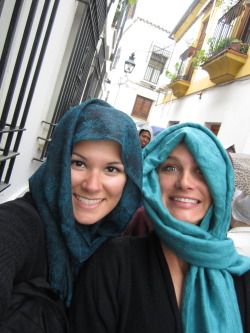 Marita and I trying to keep our hair dry