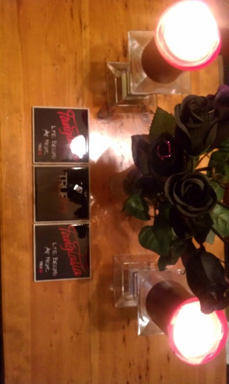 Fangtasia/True Blood coasters, black candles and black roses.