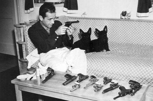 Humphrey Bogart with his gun collection.