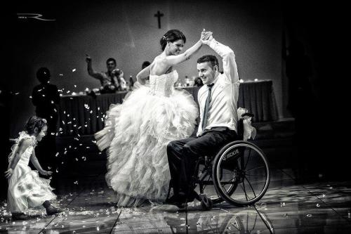 lady dancing with man in wheelchair