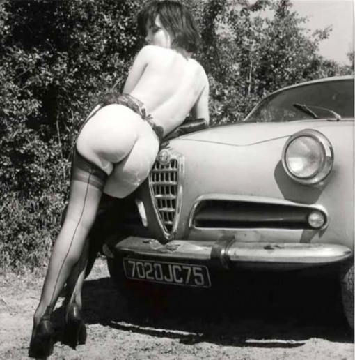 wickedknickers:  Cheeky lass…  Love those Italian lines! Nice vintage car, too.