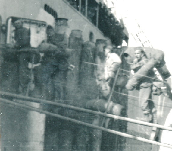 253a. Enlargement of photo No. 253. On the gangplank loading for the trip to England Le Harve France 7 August 1945