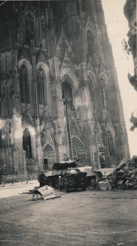 264. Cologne Cathedral practically untouched. City badly damaged.  Sign reads: Sight Seers Keep Out Fighting Men