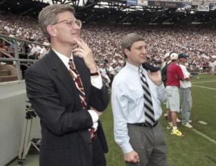 Penn State athletic director Tim Curley (L) and Penn State president Graham Spanier watch the Nittany Lions' football game against Texas Tech from the sidelines of Beaver Stadium in State College, Pennsylvania in this September 9, 1995 file photo.