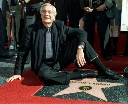Academy award winning actor Martin Landau sits on his new star on the Hollywood Walk of Fame, as he poses for photographers during ceremonies to honor him, in Hollywood, U.S.