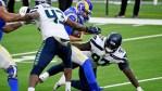 Seahawks hope to slow down Carlos Dunlap's foot...