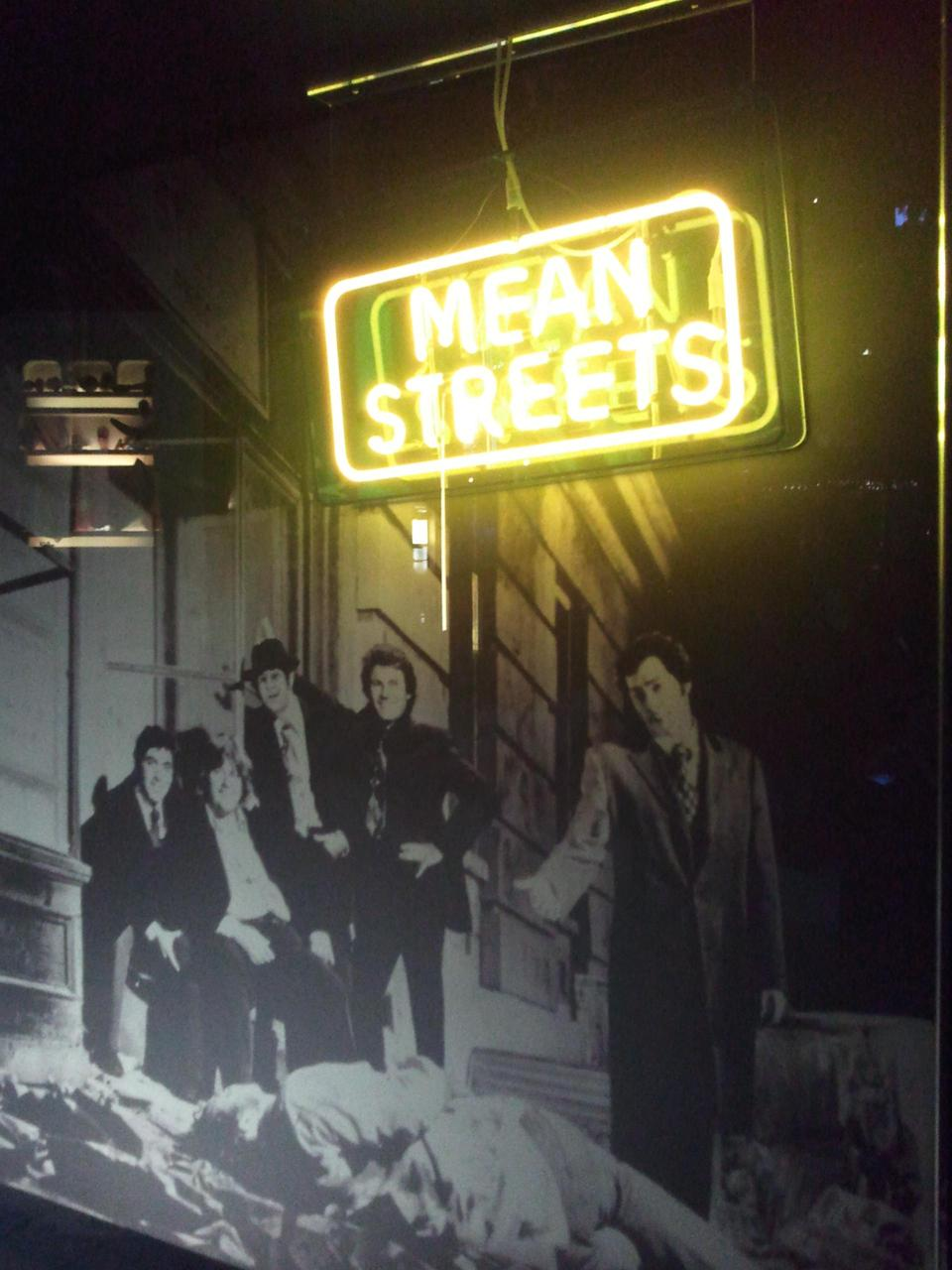"Mean Streets Neon Sign & Press Photo The neon sign was not used in the film, but only in the promotional photo. It was added in a second moment to the picture, looking much larger. Even the actors in this photo are not ""real"": the publicity still was taken first with stand-in models and the actors' heads were added later with a photo montage."