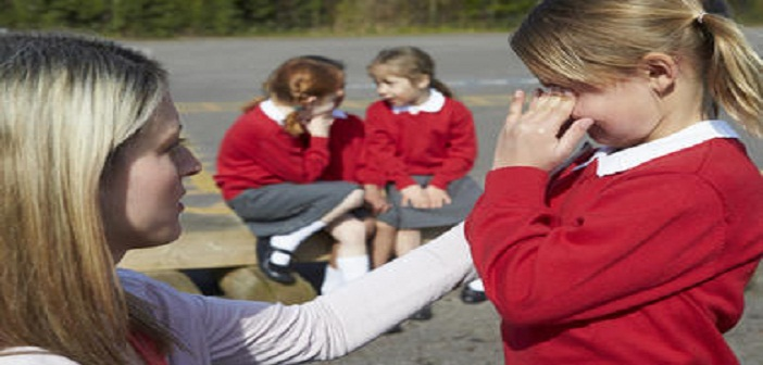 Teacher Comforting Victim Of Bullying In Playground,blog.prediss.com