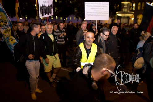 PEGIDA marshall pushing counter protestor.