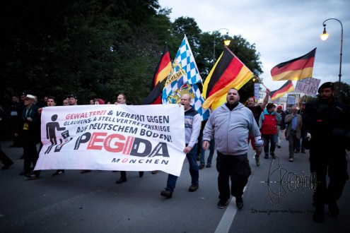 """Racists march agianst the """"islamization"""" and refugees being accepted."""