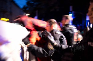 Riot force police brutally pushes away counter protestors.