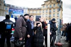 Kathrin Oertel posing in front of noSIKO demonstration