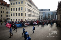 "At least 1000 demonstrators rallying through Dresden against racism, nationalism and ""Fortress Europe""."