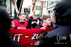 Karl Heinz Statzberger leading neonazi mob in Ingolstadt posing with lifted fist - a clear neonazi salute.
