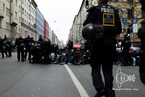 Antifacist activists try to block marching route
