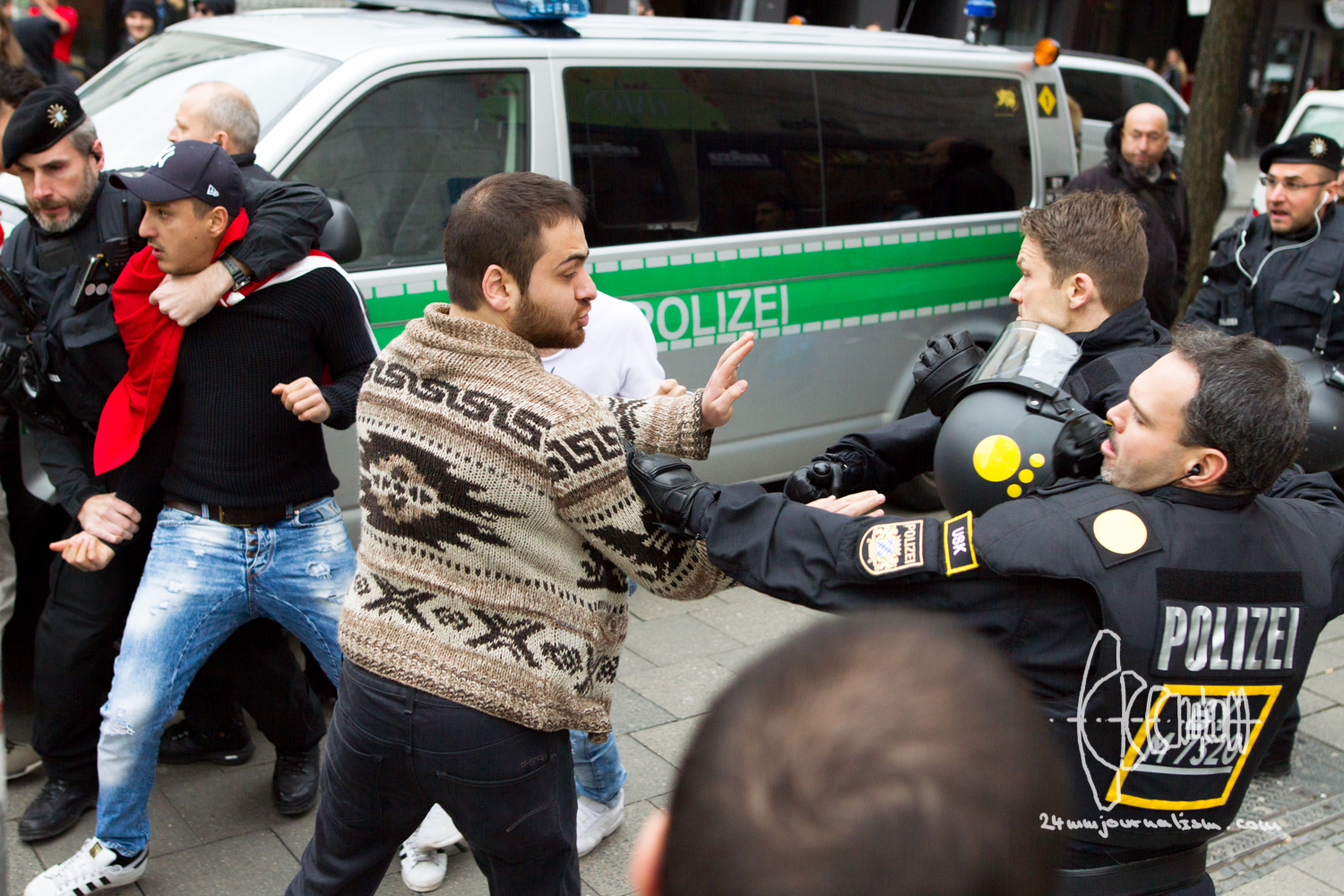 After a participant attacks a Kurdish bystander with a kick police intervenes.