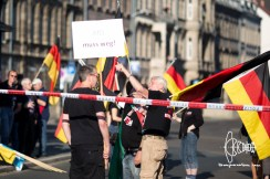 """Counter protestor sneaks into PEGIDA mass with a sign stating: """"AfD has to go!"""""""