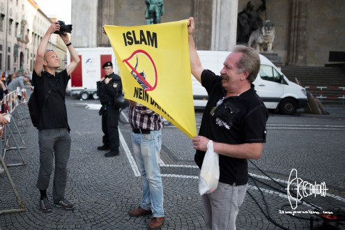 PEGIDA participants block journalist's camera