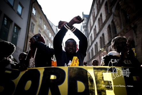During a demonstration against the new Integrationlaw of Germany in Munich, police violence errupts after color bags were thrown. More then fifty people were wounded by police. Refugee crossing arms.
