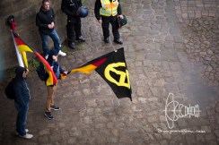 Man with flag of Identitarian movement