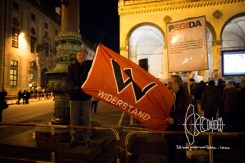 Neonazis carry flag of 'Aktion Widerstand'.