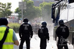 Police and protesors face each other