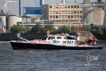 Boat with pro-refugee banner