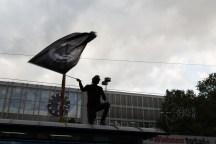 Counter protestor waving flag