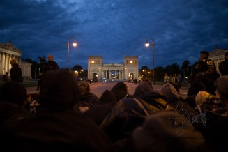 Antifacist protestors block together with local political party members the road at historically charged Königsplatz in Munich.